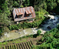 Small house with the river in Banaue, Philippines Royalty Free Stock Image