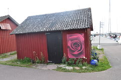 Small house with rose. Small house with red rose Stock Photos