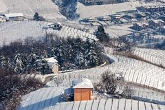 Small house on snowy hill in Italy stock photos
