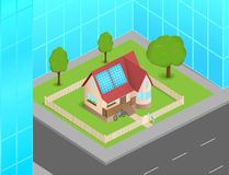 Small house with solar cells between skyscrapers Royalty Free Stock Images