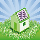 Small house with solar panels in natural landscape Royalty Free Stock Image
