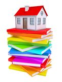 A small house on a stack of colorful books Royalty Free Stock Image