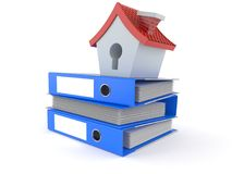 Small house on stack of ring binders Royalty Free Stock Images