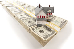 Small House on Stacks of Hundred Dollar Bills Royalty Free Stock Images