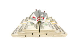Small House on Stacks of Hundred Dollar Bills. Isolated on a White Background Stock Photos