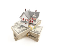 Small House on Stacks of Hundred Dollar Bills Stock Photos