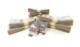 Small House with Stacks of Hundred Dollar Bills Royalty Free Stock Image