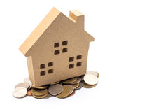 Small house standing on coins. The concept of purchase of habita Stock Image
