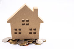 Small house standing on coins. The concept of purchase of habita Stock Photography