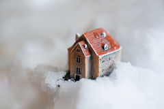 Small house standing on snow Royalty Free Stock Photos