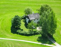 A small house surrounded by trees in the middle of a field near Vienna. Austria stock photo
