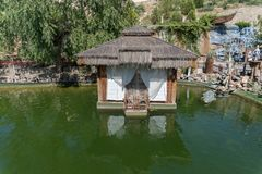 Small house or tea room on a lake. Small house or tea room on a lake with trees on background Royalty Free Stock Photography