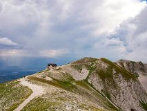 Small house on top of the mountain stock images