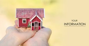 Small house in two hands sun pattern. On nature blurred background Stock Image