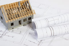 Small house under construction and electrical drawings, concept of building home Stock Images