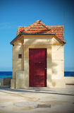 Small house on the waterfront Royalty Free Stock Images