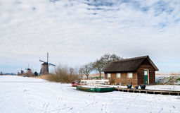 Small house and windmills Royalty Free Stock Images