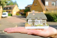 Small house in womans hand Royalty Free Stock Photo