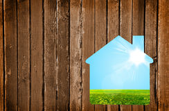 Small house on a wooden wall Stock Photography
