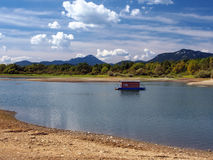 Small houseboat and shore in summer Royalty Free Stock Photo
