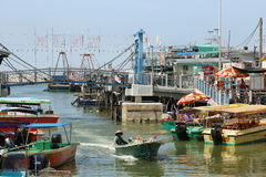 Small houses and boats in Tai O fishing village Stock Photos