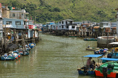 Small houses and boats in Tai O fishing village Stock Image