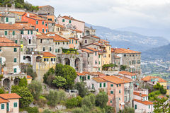 Small houses chaotically standing on the hill in Italy Stock Images