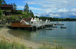 Small houses on coast royalty free stock photos