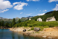 Small houses on Devero lake Stock Photo