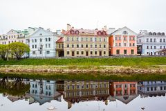 Small houses of different colors on embankment Stock Photos