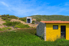 Small houses on green hill Stock Image
