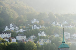 Small houses on hills Stock Images