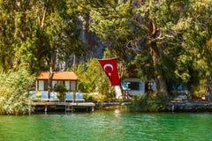 Small houses on Lake Koycegiz. Turkish flag. Trees. Turkey. Small houses on Lake Koycegiz. Turkish flag. Trees stock images