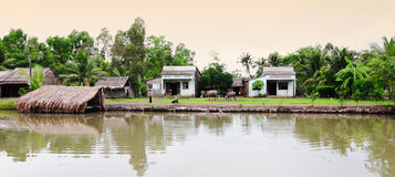 Small houses located on the river bank in Tra Vinh, Vietnam Stock Photography