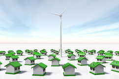 Small houses looked at a wind generator. A wind generator is placed in the middle of rows of small houses arranged in concentric circles and look at it, on a Stock Photography