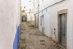 Free Small Houses On The Narrow Street Of Historic Olhao, Algarve, Portugal Stock Photos - 214808313