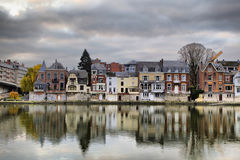 Small houses reflecting in river Meuse at the morning, Namur Stock Photography