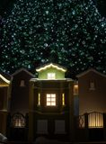 Small houses under the Christmas tree. Christmas decoration Royalty Free Stock Photos