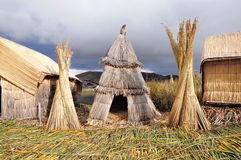 Small houses on Uros islands. Royalty Free Stock Images