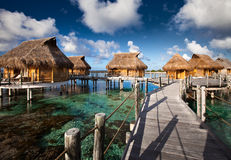 Small houses on water in the ocean Stock Photography