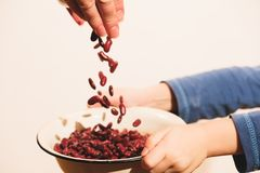 Small hungry child gets food donate help a volunteer, with bowl full of beans. Small hungry child gets food donate help to a volunteer, hands with bowl full of Stock Photography