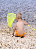 Small hunter. Small boy on the beach Stock Photos