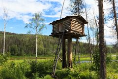 A small hunting house on a pole. Siberia, Russia Stock Photography