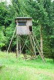 Small hunting shelter seat in the woods stock image