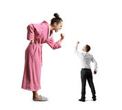 Small husband looking at his wife. Scold wife screaming and fist, small husband looking at his wife and showing fist. isolated on white background Royalty Free Stock Photography