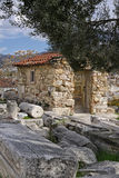 Small hut in the Acropolis of Athens surrounding area. Small stone hut near the Theatre of Dionysus Eleuthereus in area of the Acropolis of Athens. In the Stock Photography