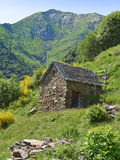 Small hut in the Alps. Small hut in the Italian Alps in the Val Grande with view to the mountain Pizzo Mottac Royalty Free Stock Image
