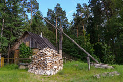 Small hut in the garden with firewood Stock Photos