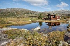 Small hut at norwegian lake Stock Photography