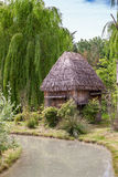 Small hut with a thatched roof. Stock Images